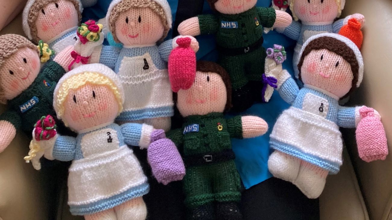 Kind Michelle Blakey has been busy knitting dolls of nurses and paramedics to raise money for Woodfield Grange's Resident activities fund.